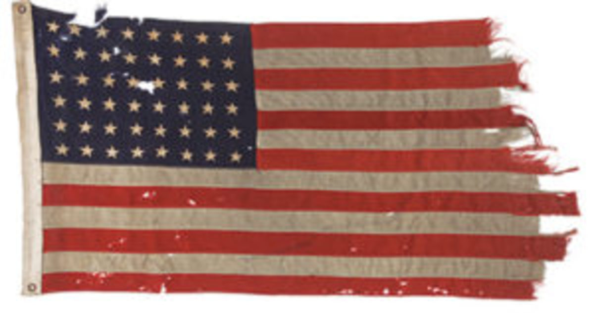 The flag flown on June 6, 1944, from the stern of Landing Craft Control 60 on the craft's solo mission to lead other vessels across the English Channel on the way to the storming of Utah Beach. Courtesy of Heritage Auctions