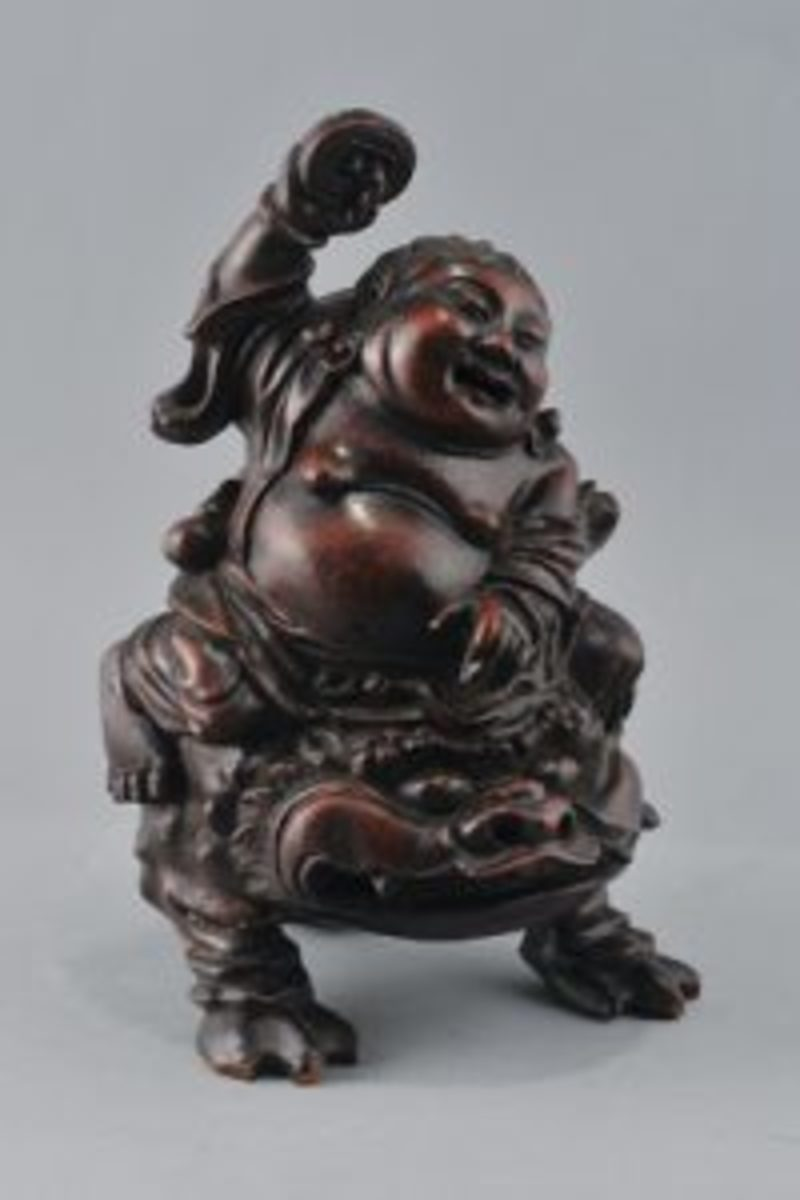 18th century Chinese bamboo root carving of the figure Liu Hai with his magic frog, 9 inches tall.