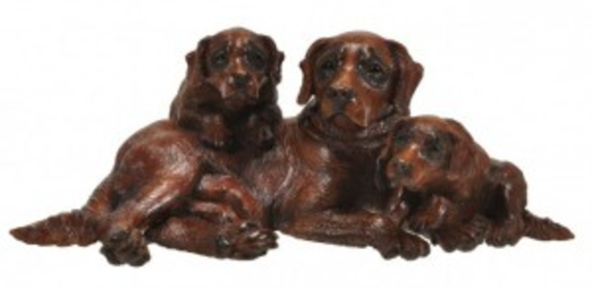 Black Forest carved and stained wood group of three Saint Bernard hounds