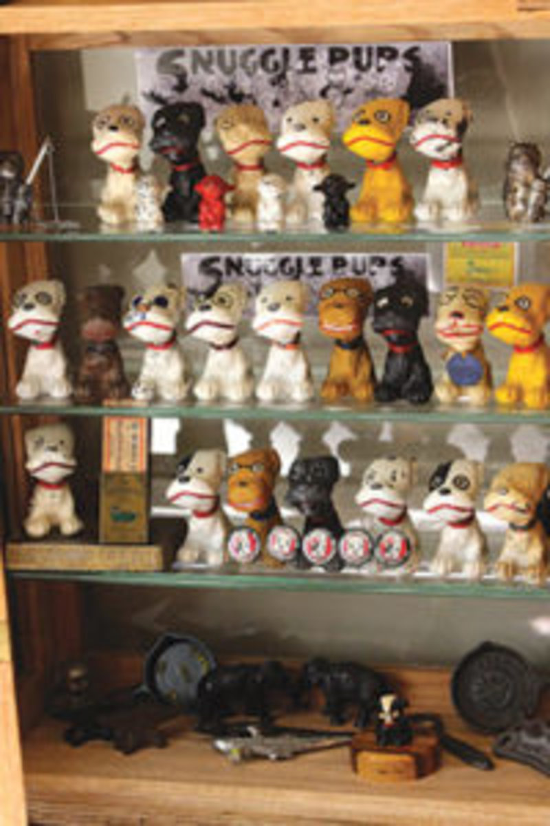 Joe's 22 of 23 Snuggle Pups, displayed in a case that he handcrafted. Image courtesy of Mary Theisen