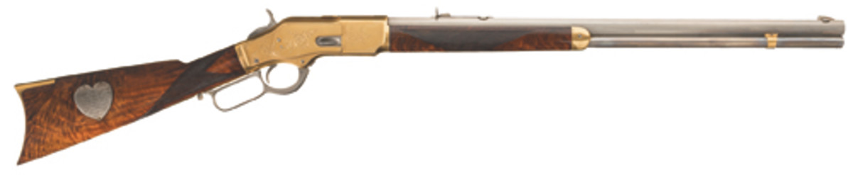 Engraved Winchester Deluxe Model 1873 lever-action rifle