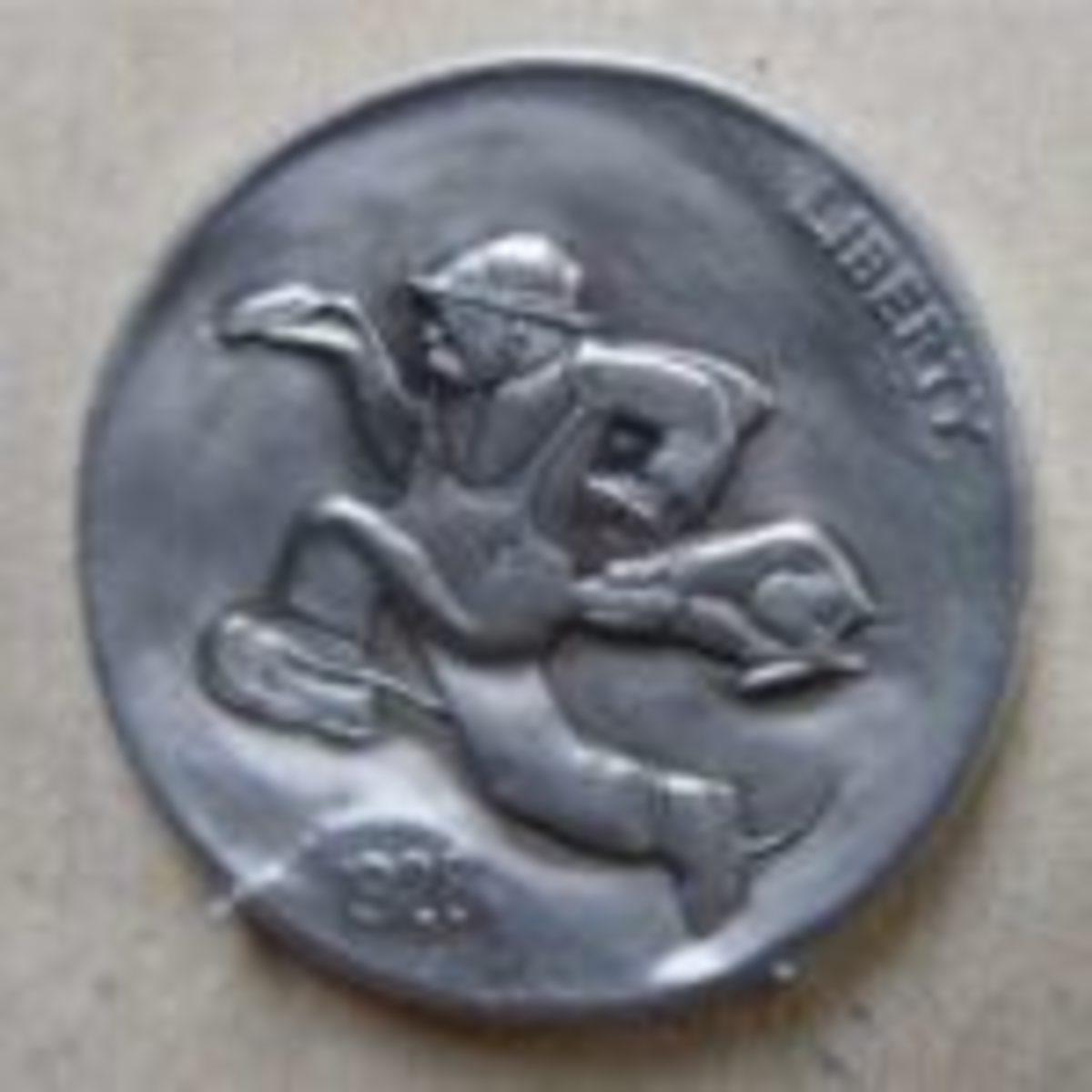 Bob Shamey carved this whimsical cartoon hobo nickel using a 1928 buffalo nickel.