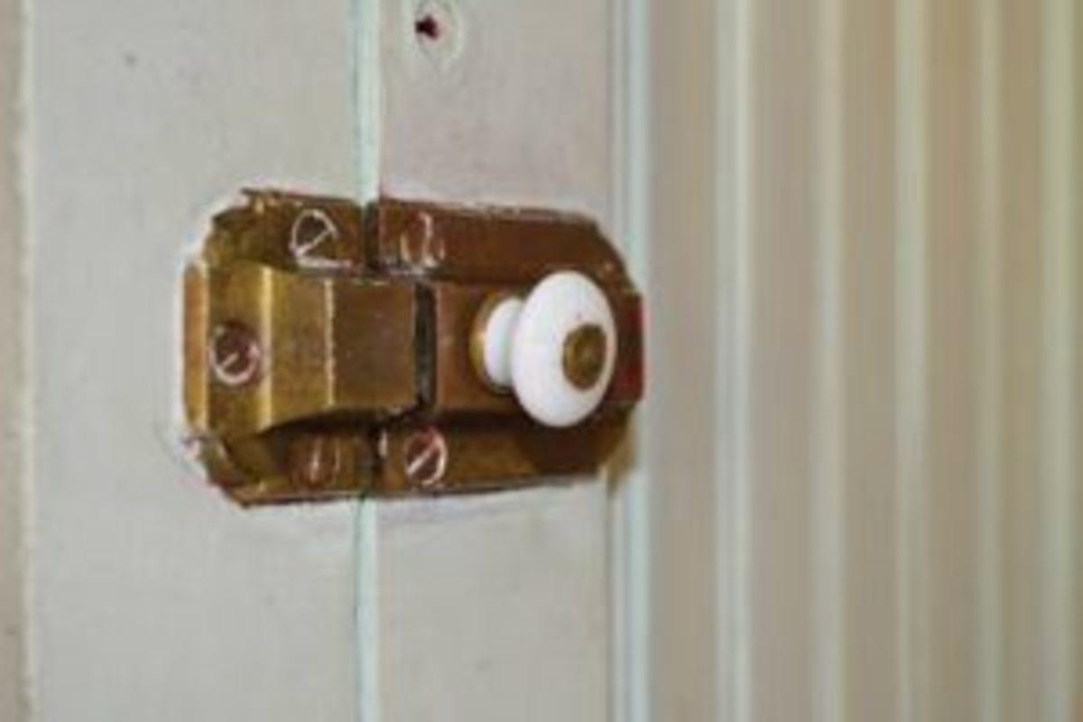Cupboard door latch