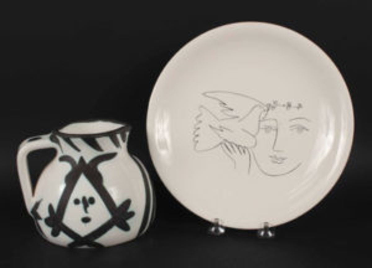 Ceramic head pitcher by Pablo Picasso (Sp., 1881-1973), for Madura, black and white with hints of blue, plus a Picasso dove and face plate, marked on verso, $4,400.