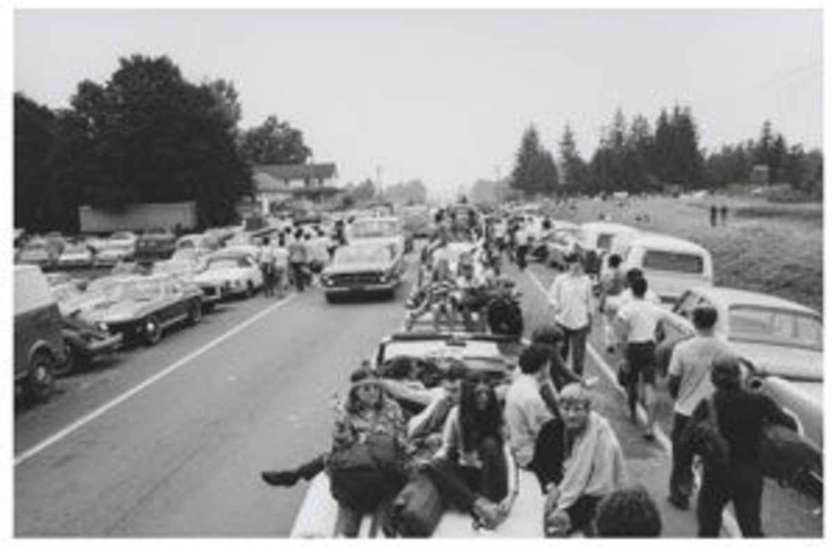 "Singer Arlo Guthrie declared from the Woodstock stage, ""The New York State Thruway's closed, man!"" He wasn't far off as incoming traffic ground to a halt, as shown in this Burk Uzzle photograph, ""Cars at Woodstock."" The 6-1/2 x 10-inch photograph sold for $1,320 at auction. Image courtesy of Heritage Auctions"