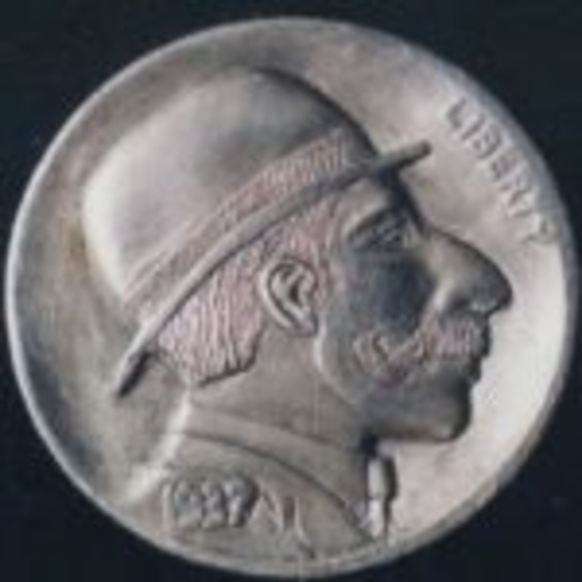 'The Driver' by Joe Paonessa. This pocket change sculpture sold for $330 at a previous Original Hobo Nickel Society auction.