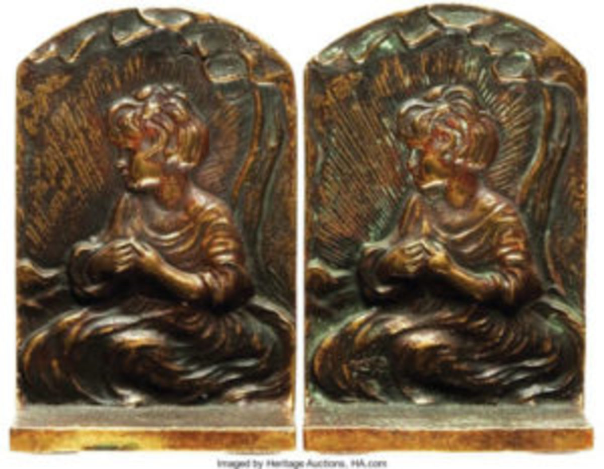 "Bookends, matching pair, depicting a seated child, signed Old English, undated, 2"" l x 3"" d x 6"" w., $15 Heritage Auctions, www.HA.com"