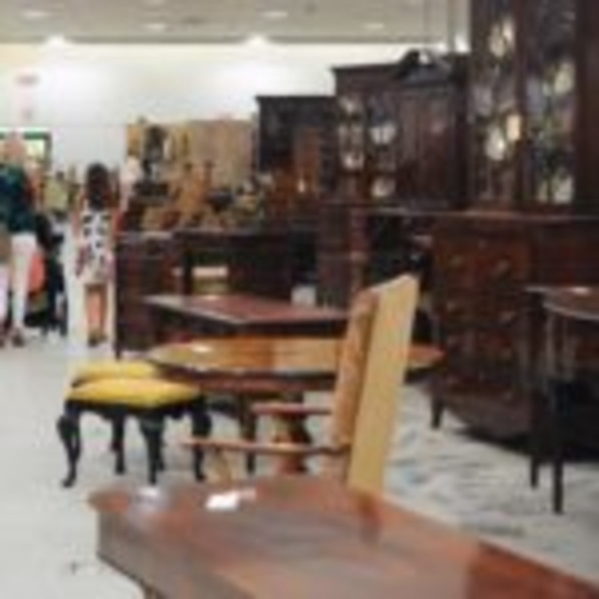 Customers browse through rows and rows of antique furniture at Scott Antique Markets in Atlanta.