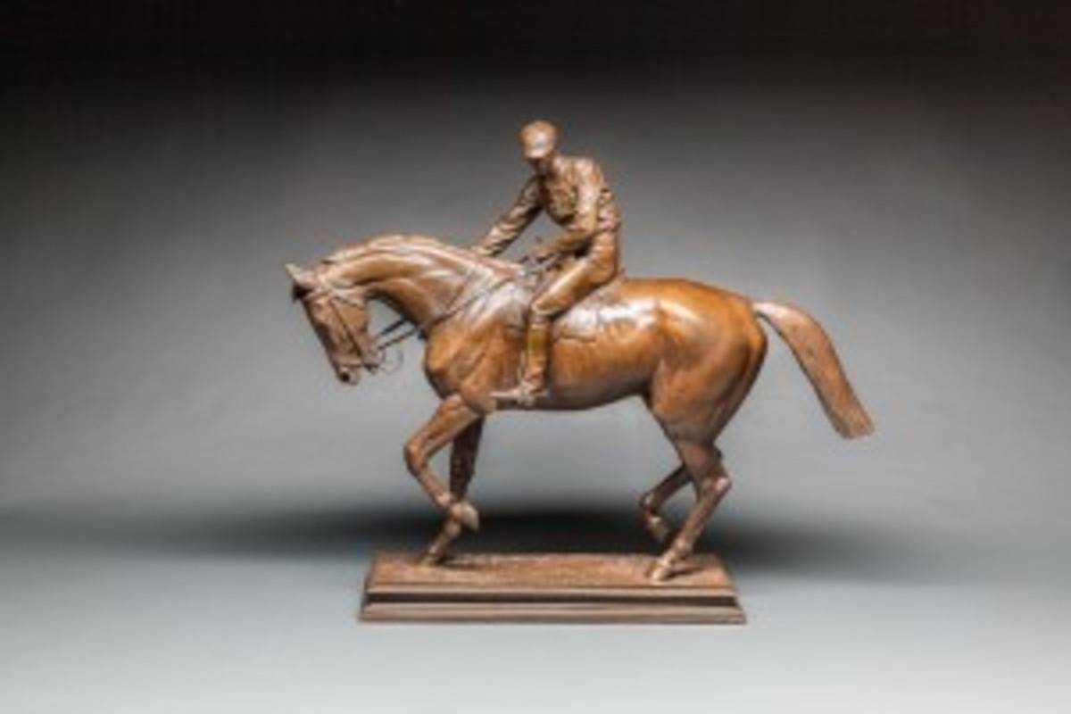 Horse and jockey bronze statue
