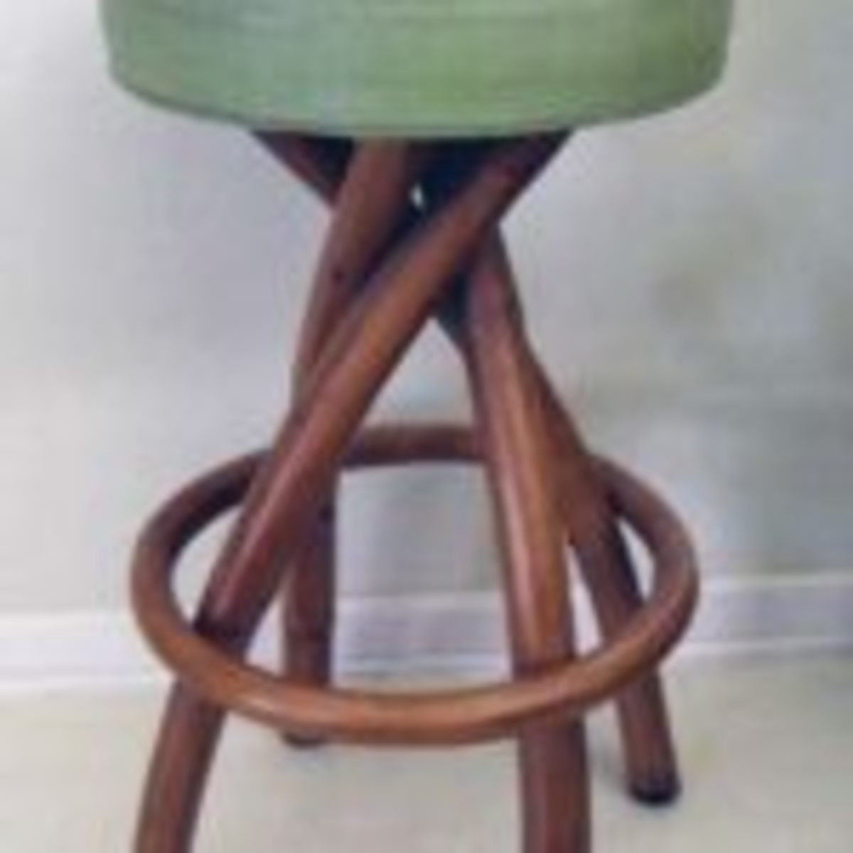 Bradston rattan bar stool, mid 20th century, 29 inches tall, seat diameter 15 inches, $125.Courtesy of Black Tulip Antiques on Ruby Lane; https://www.rubylane.com/shop/blacktulip