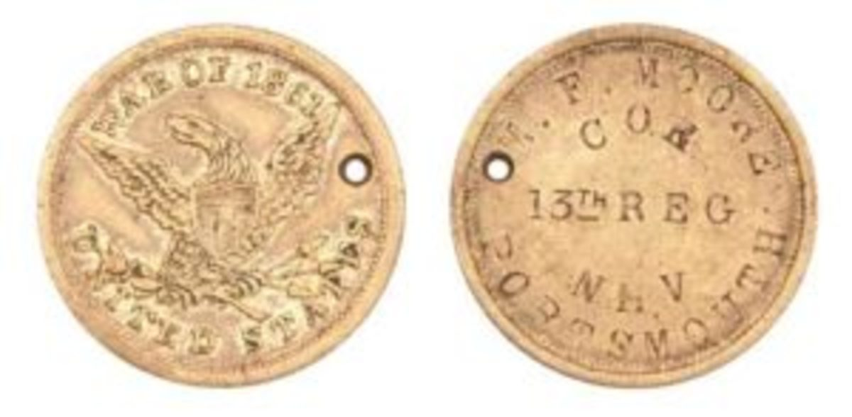New Hampshire Soldier's Eagle War of 1861 ID tag. M. (Martin) F. Moore's name is stamped on the back.