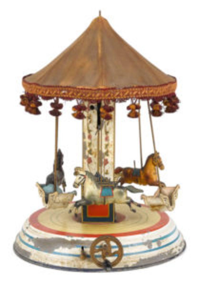 Märklin painted tin clockwork musical carousel.