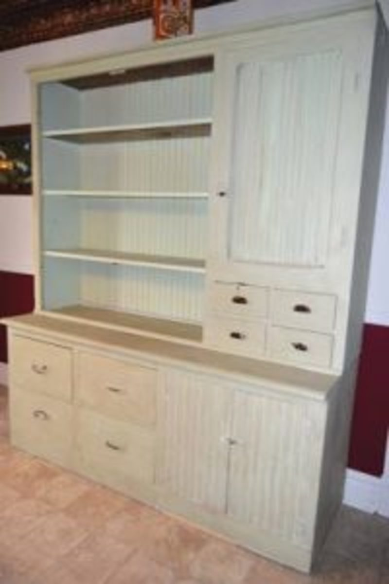 The newly painted old cupboard placed in its permanent home. Dark Oak paste wax gives the paint an aged finish.