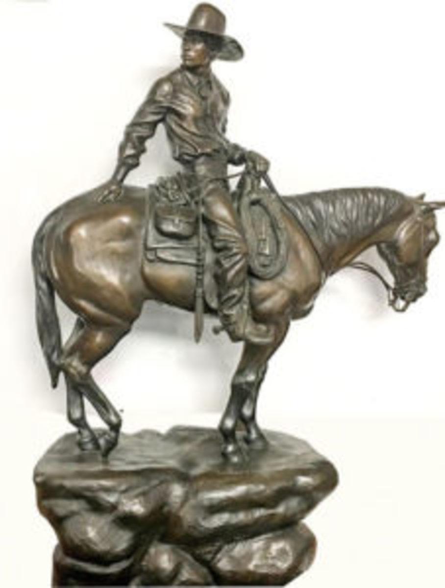 Bronze cowboy sculpture
