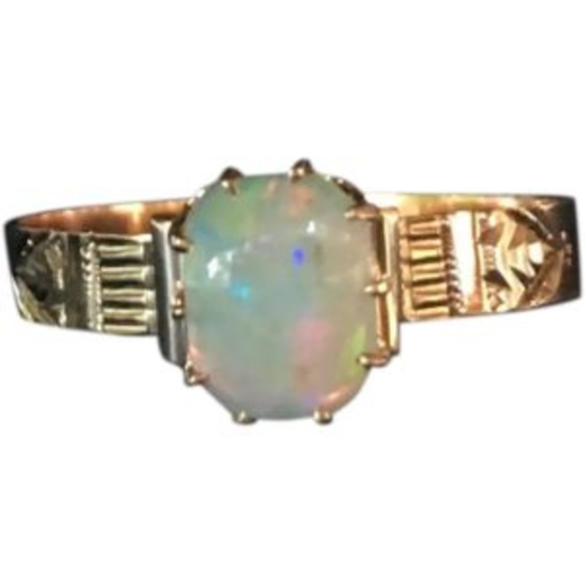 Victorian 14 karat rose gold opal ring size 10. The cushion cut rectangular Opal cabochon is 1.00 ct. $540. Courtesy of Ruby Lane