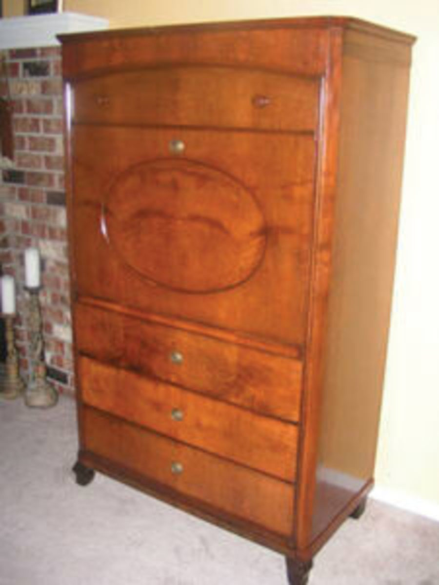 """An imposing word for a closed up desk. The secretaire part is pretty easy to figure. But """"abattant""""? It refers to the drop front meaning flat and articulated loose flap."""