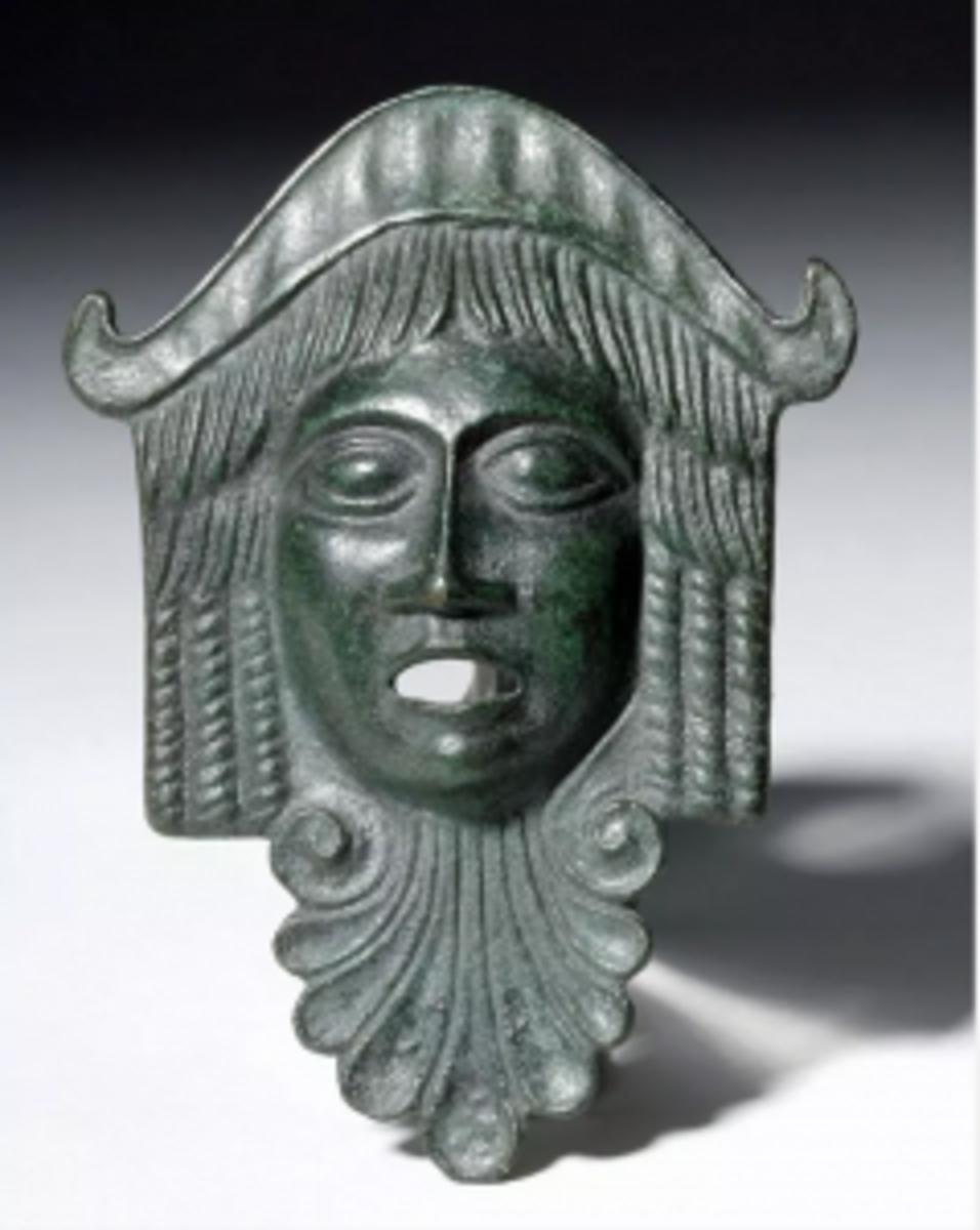 Roman bronze-applique actor's mask form, circa 1st-4th century CE, est. $900-$1,400