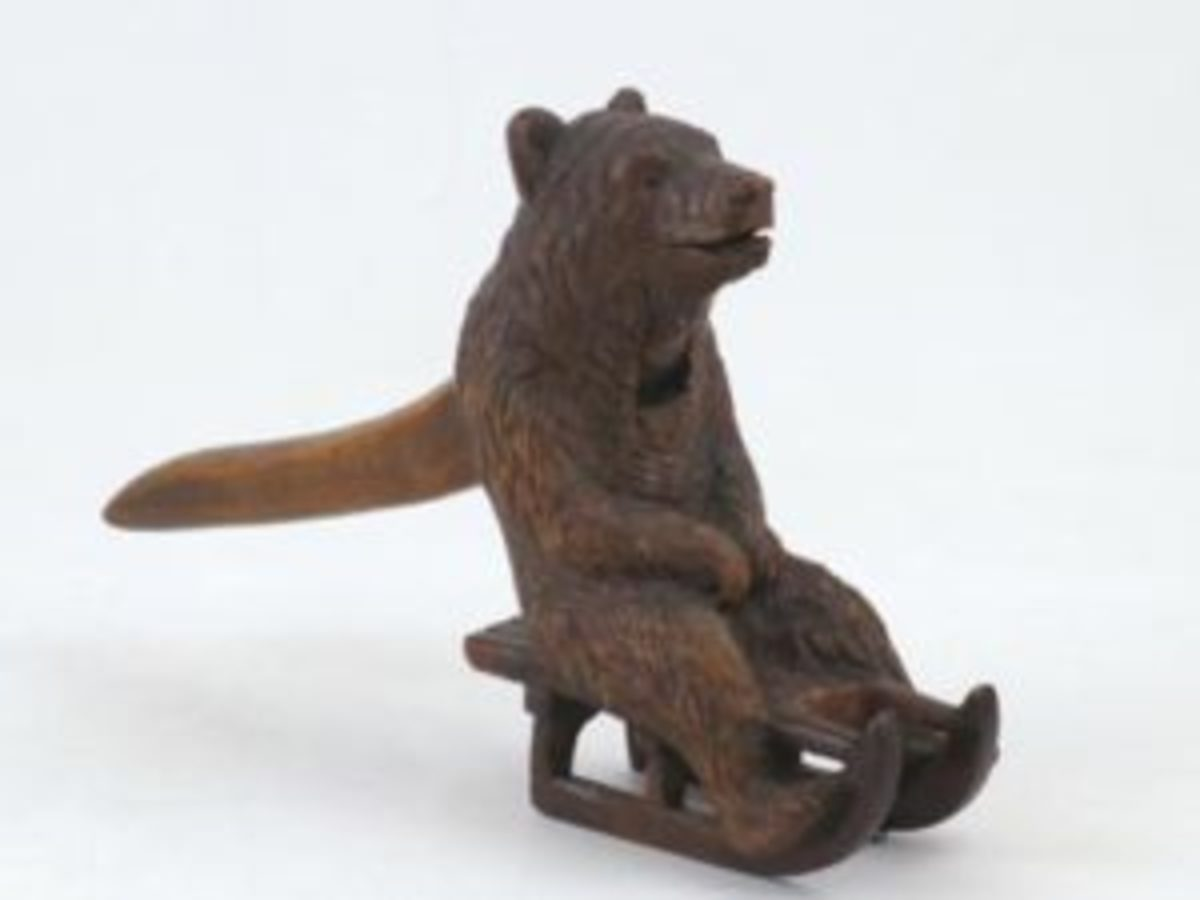 """Bear on a sled - late 19th century, Switzerland, Beech wood, 5"""" tall. Courtesy of Arlene and George Wagner"""