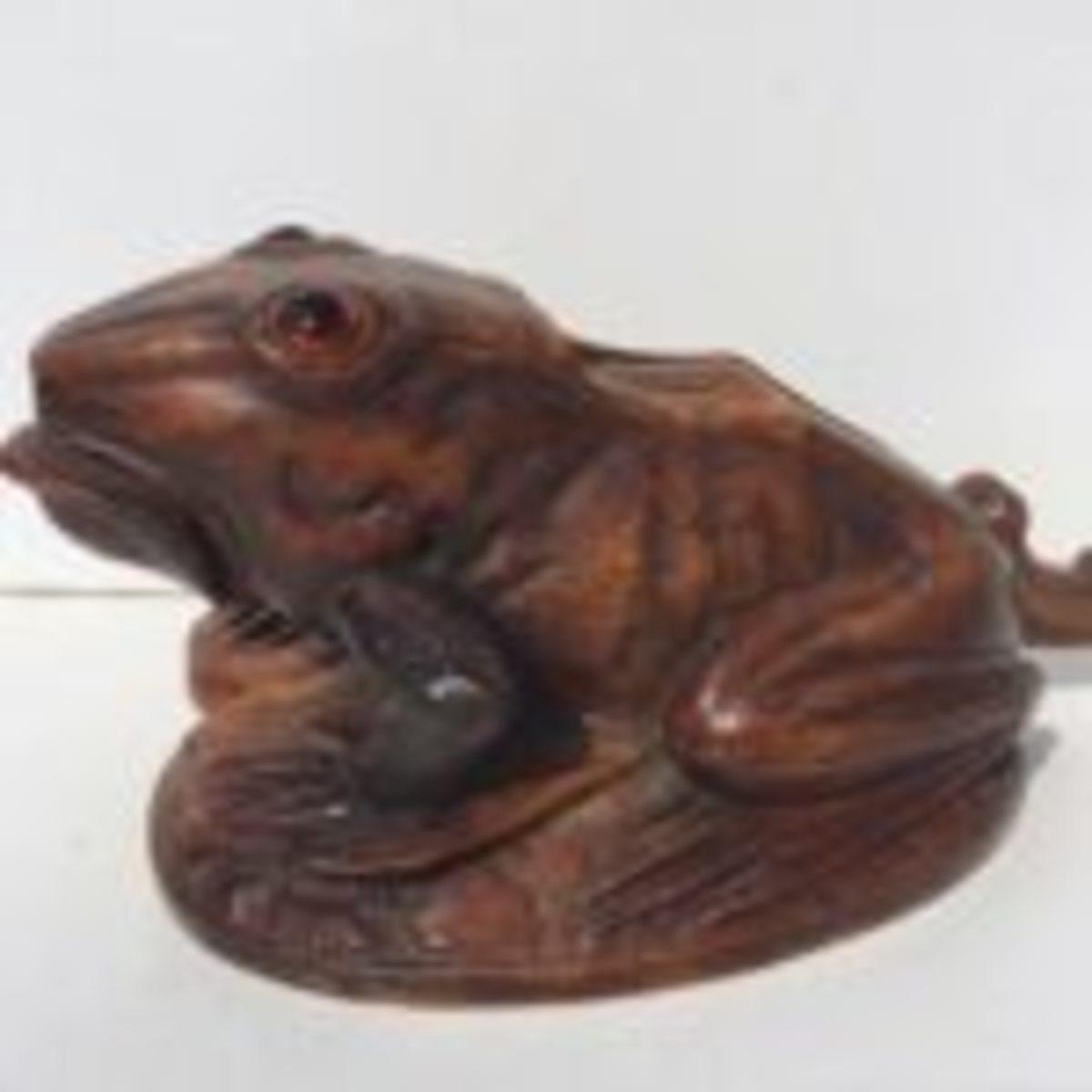 carved frog nutcracker
