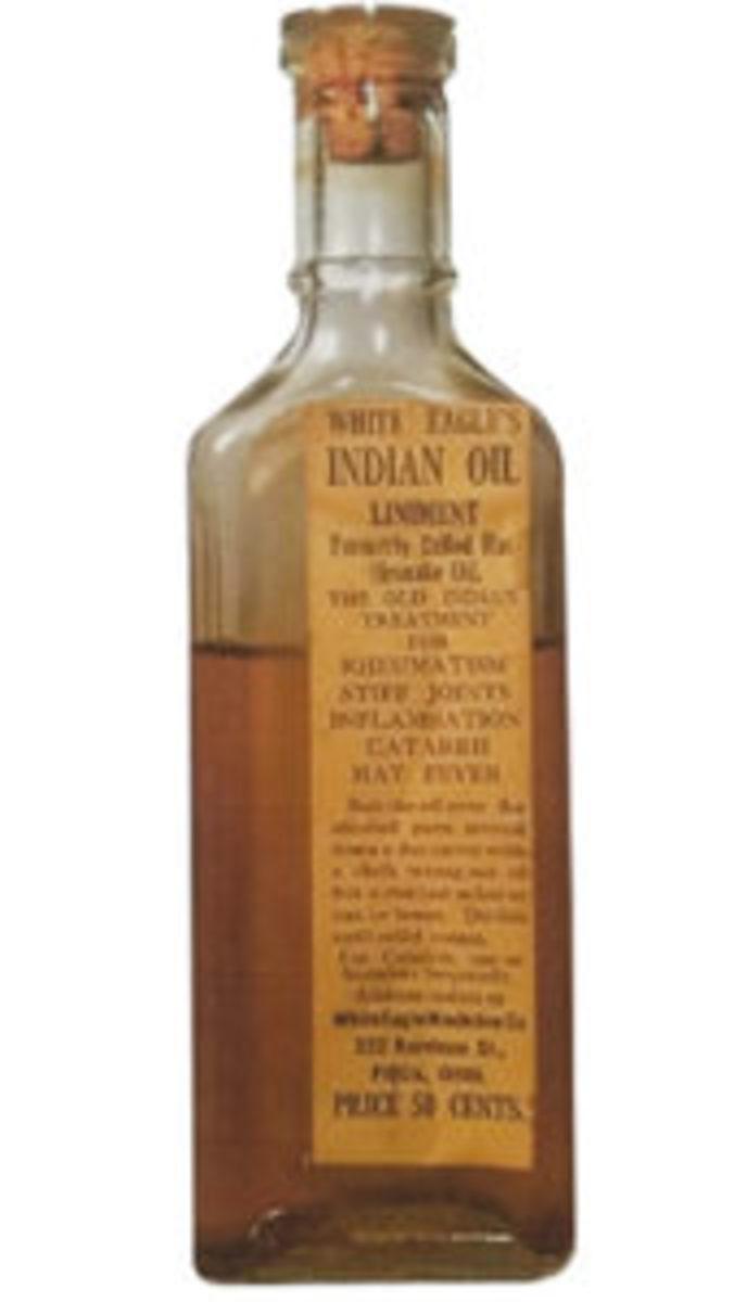 """Figure 1: White Eagle Indian Oil Liniment, 5 ½"""", Clear, White Eagle Medicine Co., 222 Harrison St., Piqua, Ohio, 1885-1900, $50-$75."""