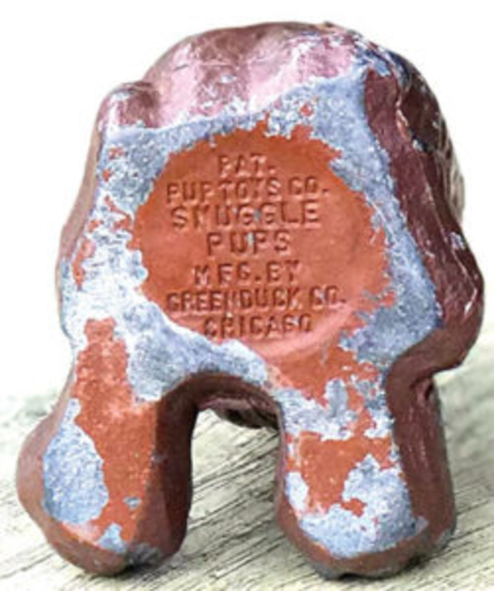 "The metal pups are marked on the bottom of the body ""PAT. PUP TOYS CO. SNUGGLE PUPS MFD. BY GREENDUCK CO. CHICAGO."""