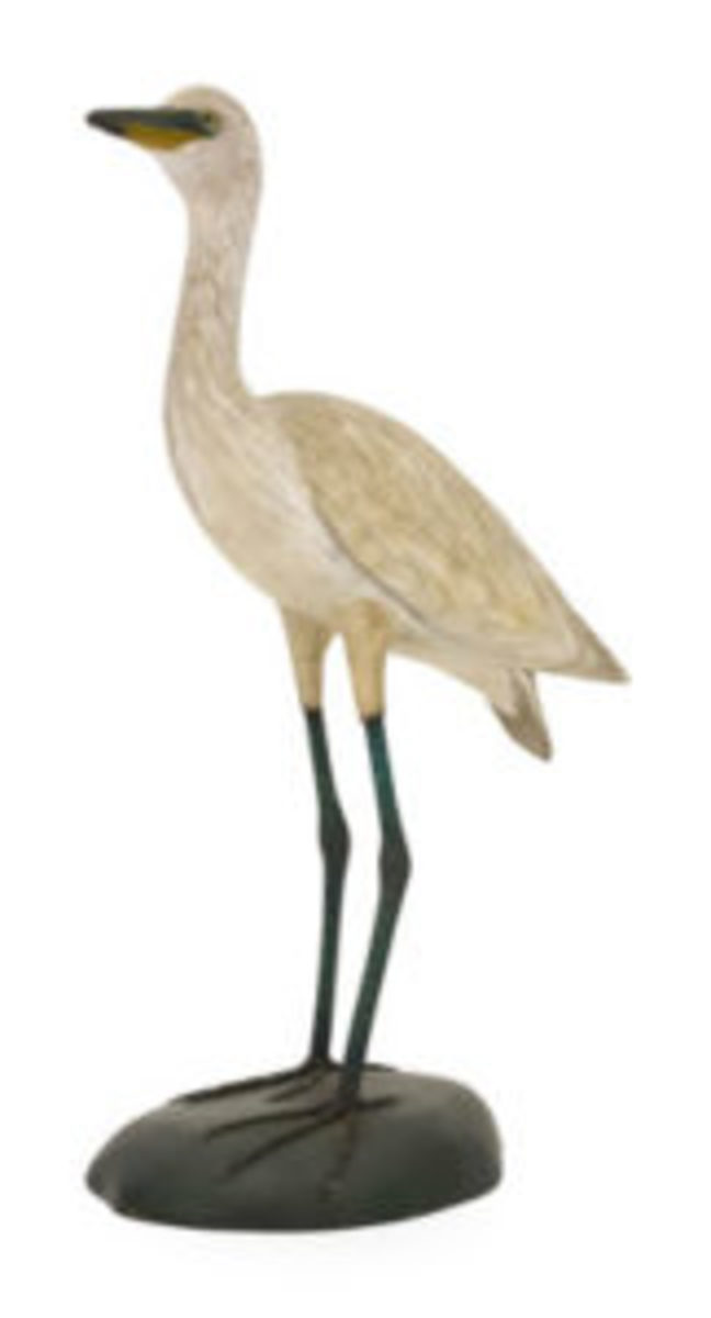 A. Elmer Crowell carved snowy egret, $48,000