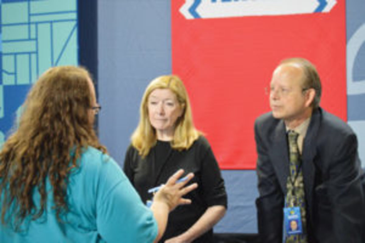 Antoinette speaking with Antiques Roadshow appraisers