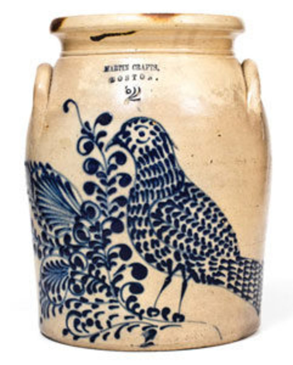 "This exceptional 2-gallon stoneware jar with elaborate cobalt bird and floral decoration, stamped ""MARTIN CRAFTS / BOSTON"", MA origin, circa 1855, sold for $17,700. Courtesy of Crocker Farm."