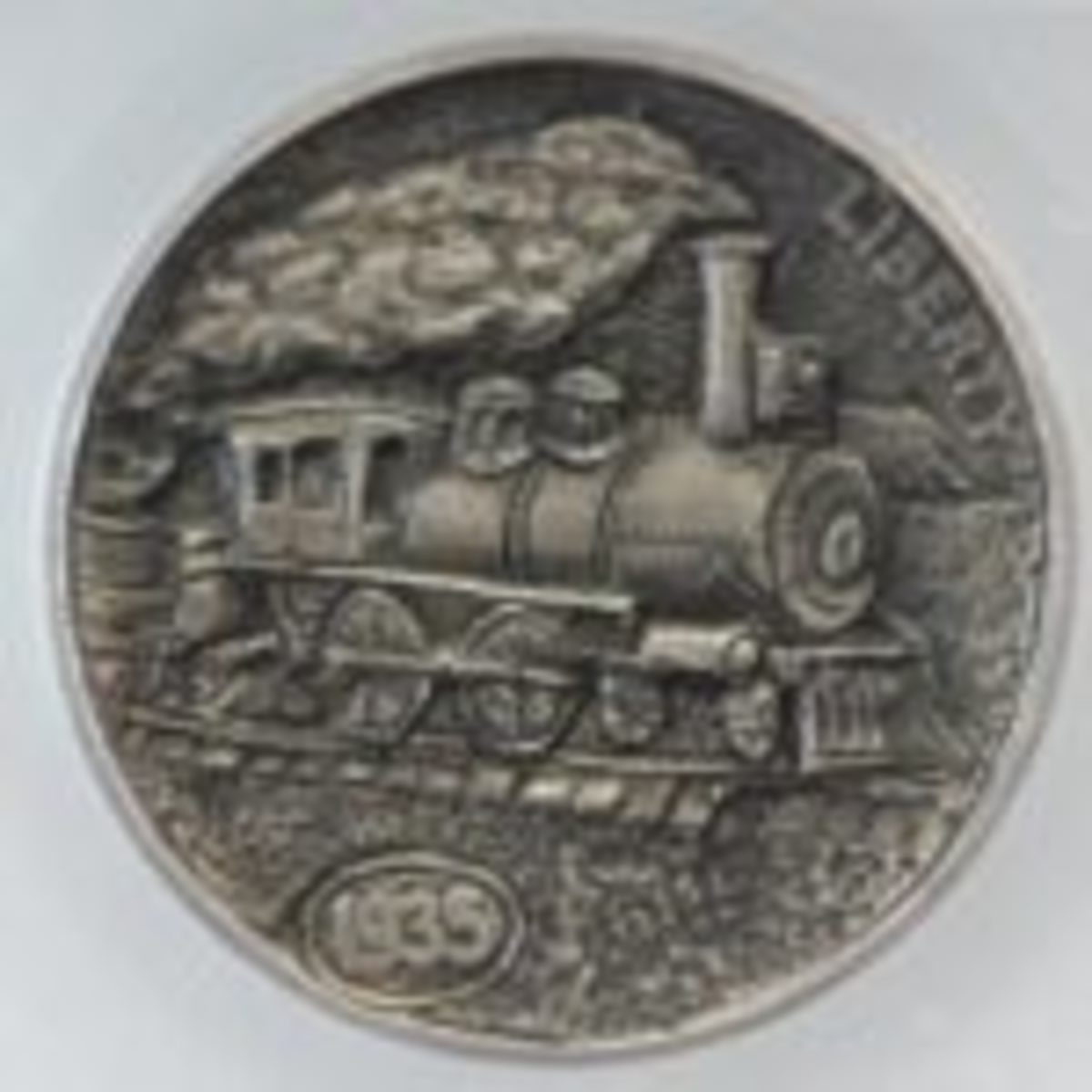 """Steam Locomotive"" by Robert Morris. Carved on obverse of this 1935 nickel. Offered at $400 on eBay."