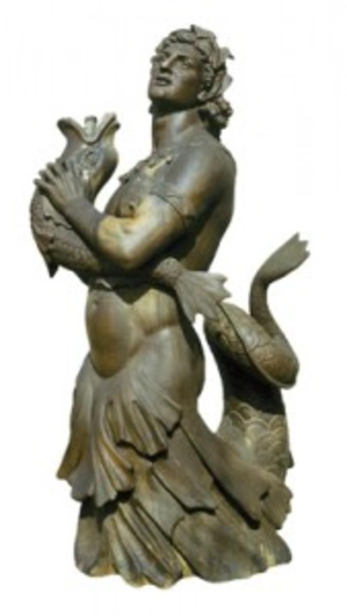 Merman patinaed sculpture