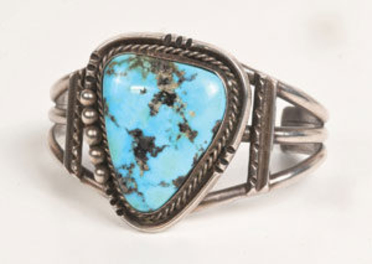 "Always at the forefront of trends and fashion, Elvis embraced the 1960s and '70s trend of Native American turquoise jewelry and accessorized his jumpsuits and himself with pieces, such as this silver cuff bracelet, with large center turquoise stone. The bracelet measures 2-3/4"" x 2-1/4"" and the turquoise stone measures 1-1/4"" x 1"". It sold at Graceland Auctions on Aug. 13 for $22,500 - far above the estimate of $8,000-$10,000. Image courtesy of Graceland Auctions"