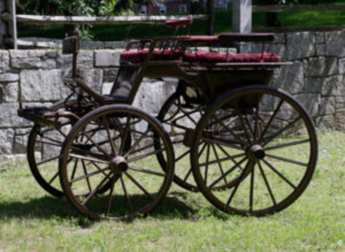 "Horse-drawn ""Fifth Wheel"" carriage, late 19th to early 20th century, measures about 70"" h x 91"" l x 51 1/2"" w., with an estimate of $1,000 to $2,000. (All photos courtesy of Kaminski Auctions)"