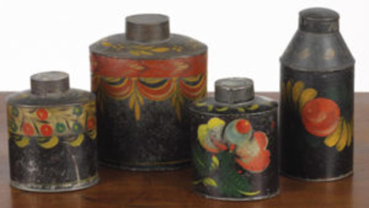 Group of four tea caddies