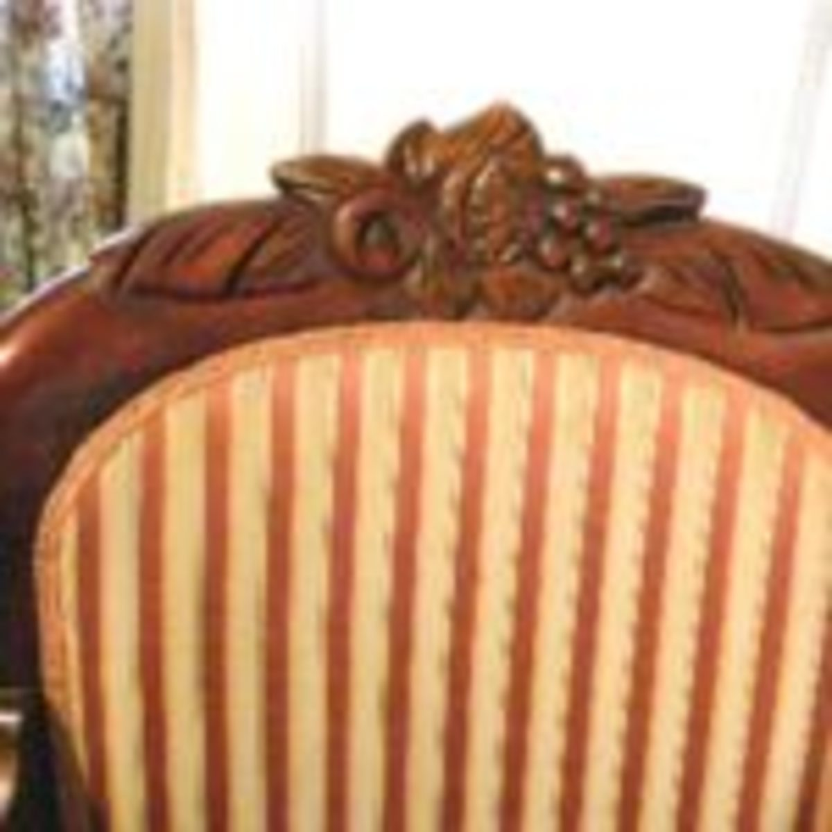 "The carving on this 1950s reproduction Rococo Revival chair is mostly spindle carved and touched up by hand. It would be a stretch to call it ""hand carved."" Fred Taylor photo"