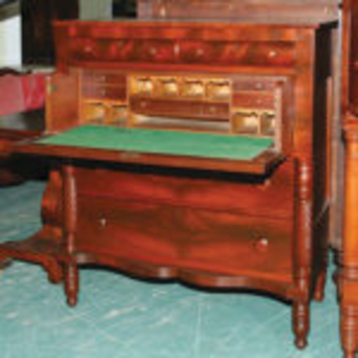 In this case the secretarial space was placed in the top drawer of chest creating the butler's desk.