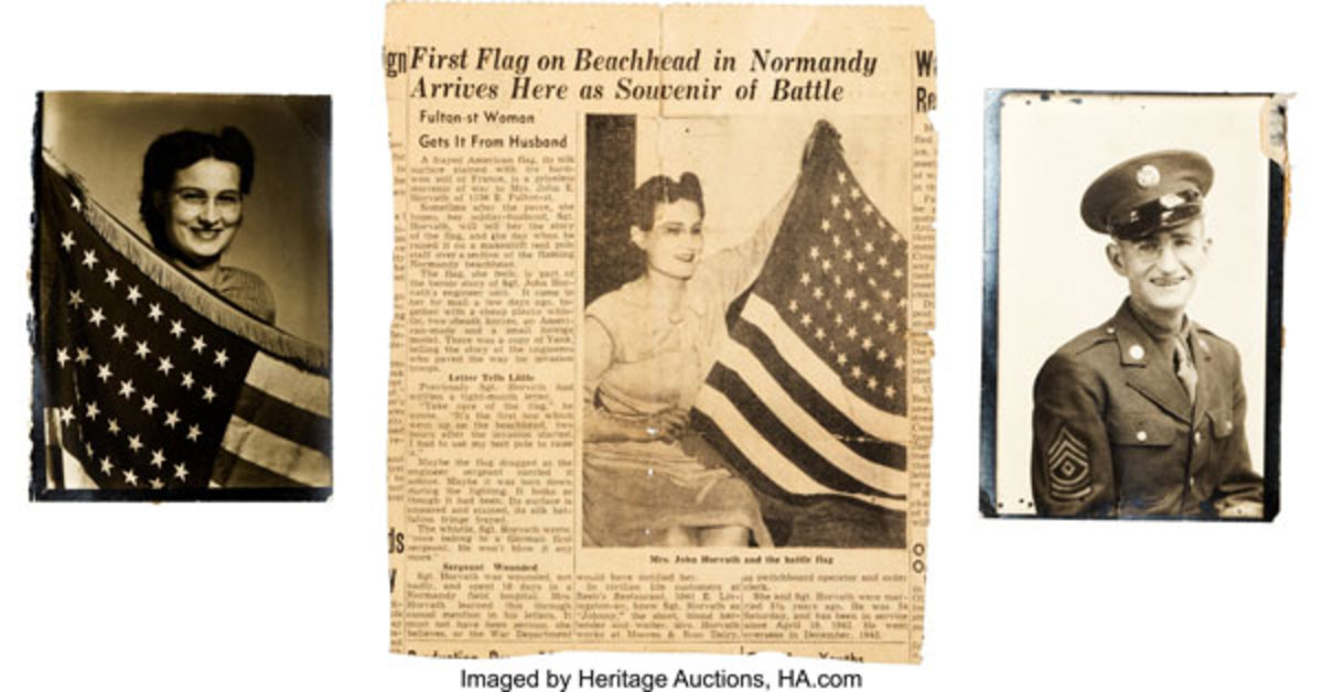Newspaper clipping included in D-Day flag lot, establishing provenance.