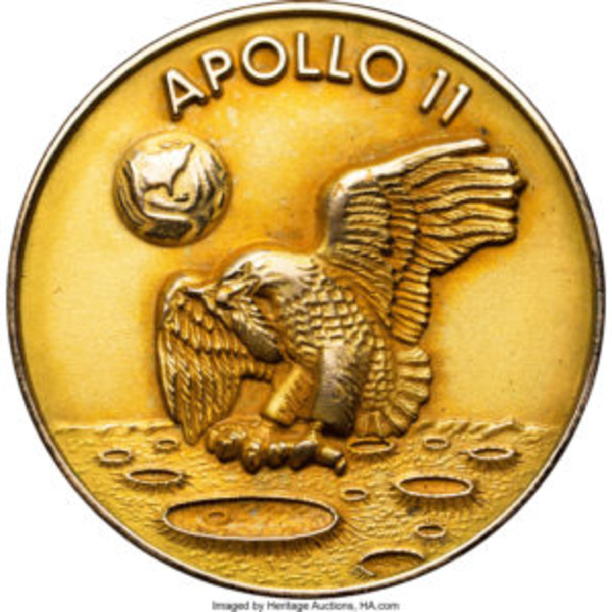 After an opening bid of $250,000, Neil Armstrong's one and only Apollo 11 Lunar Module Flown MS67 NGC 14K Gold Robbins Medal ended with a winning bid of $2,055,000. This CAG certified 28mm medal was one of only three specially minted gold medals flown aboard Apollo 11, one for each member of the crew: Neil Armstrong, Michael Collins and Buzz Aldrin. The obverse, above, depicts Collins' early and original concept for the mission insignia with the eagle carrying an olive branch in its mouth. The reverse, below, has the dates of the mission, surnames of the crew and the gold hallmark. From the Neil Armstrong Family Collection. Courtesy of Heritage Auctions