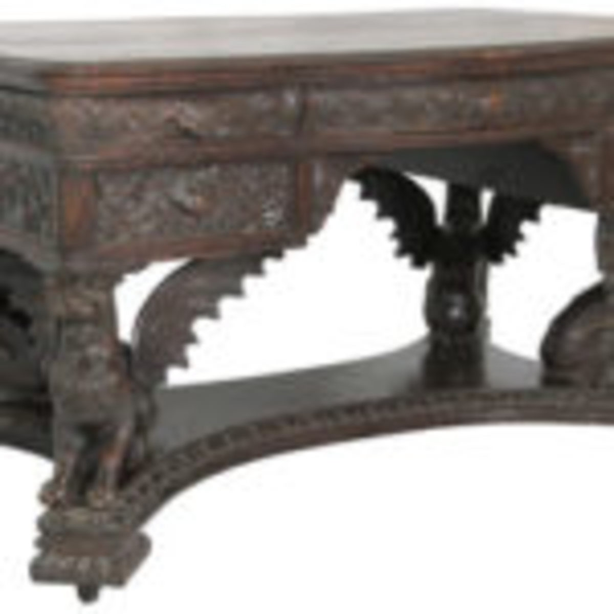 Another example of highly carved furniture is this R.J. Horner oak winged griffin partners desk ($8/12,000).