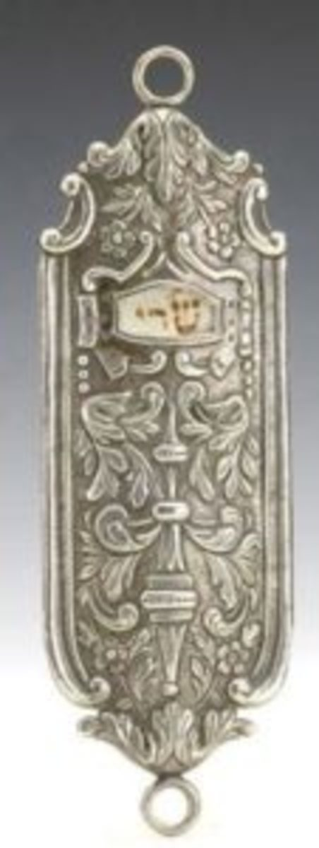 "Richly designed silver mezuzah including parchment, 8.46"" long, circa 1900, possibly Continental, realized $1,093 including buyer's premium. Courtesy Tiroche Auction House, www.tiroche.co.il"