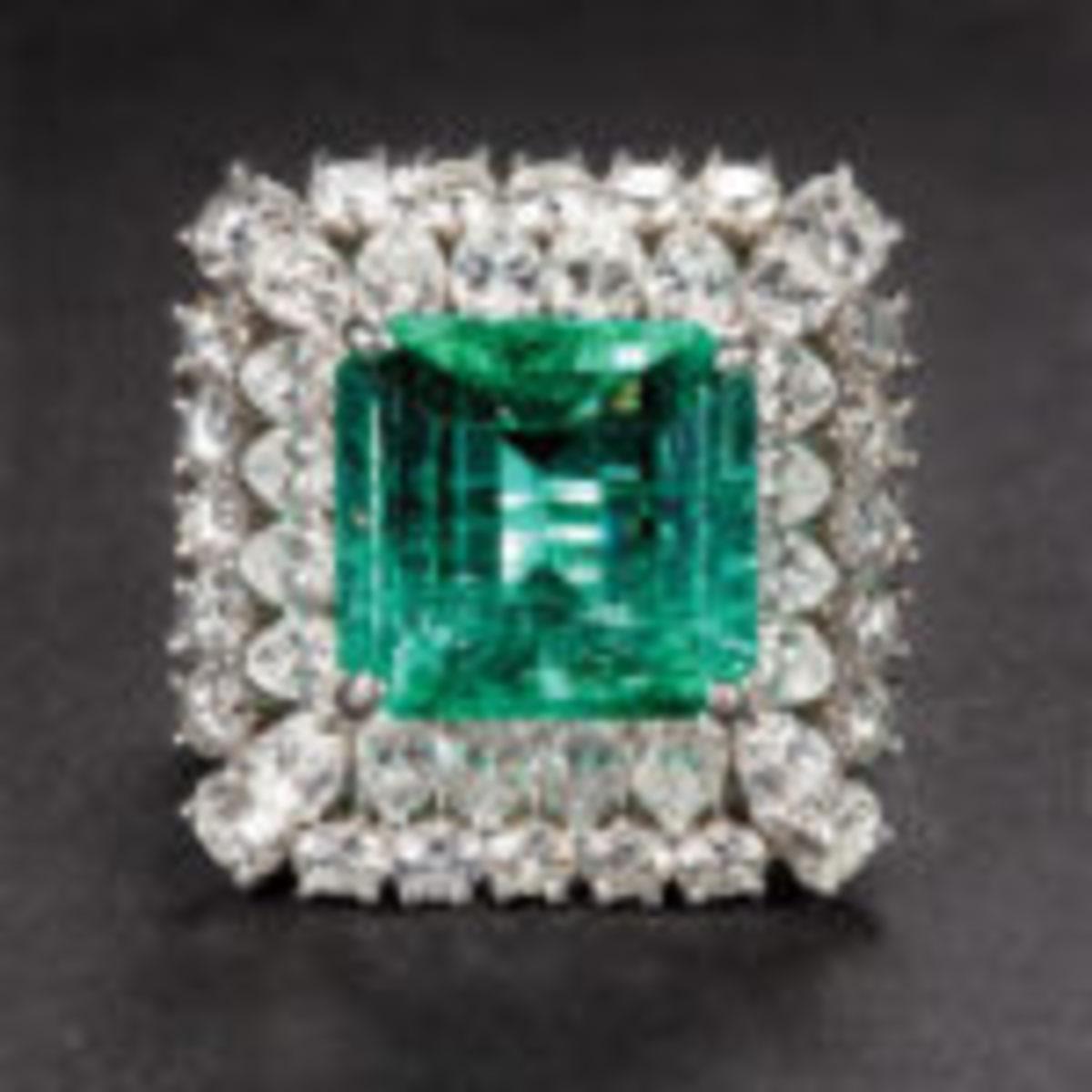 A 7.58 carat emerald, diamond, and platinum ring.