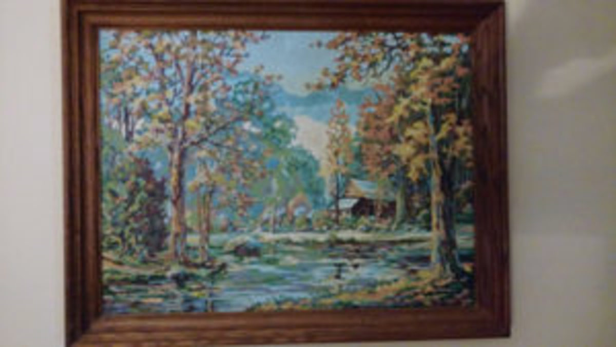 Cabin with creek painting