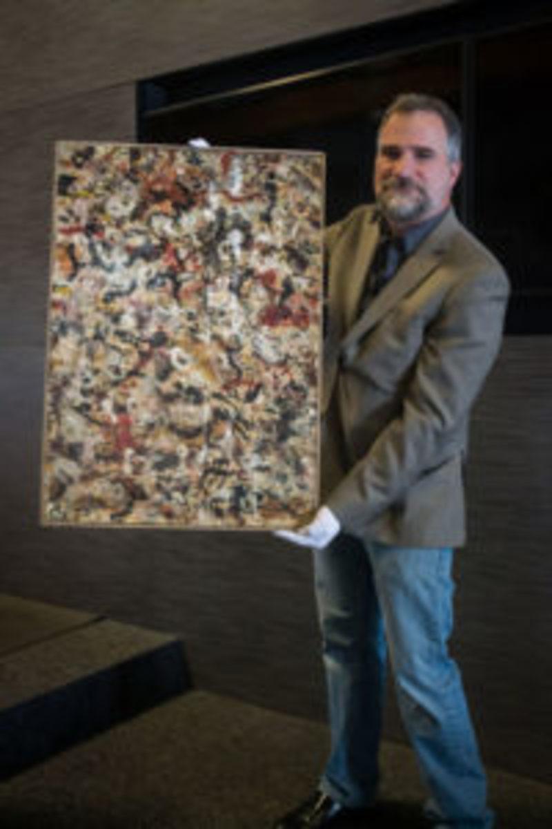 "Josh Levine holding ""lost"" Pollock"