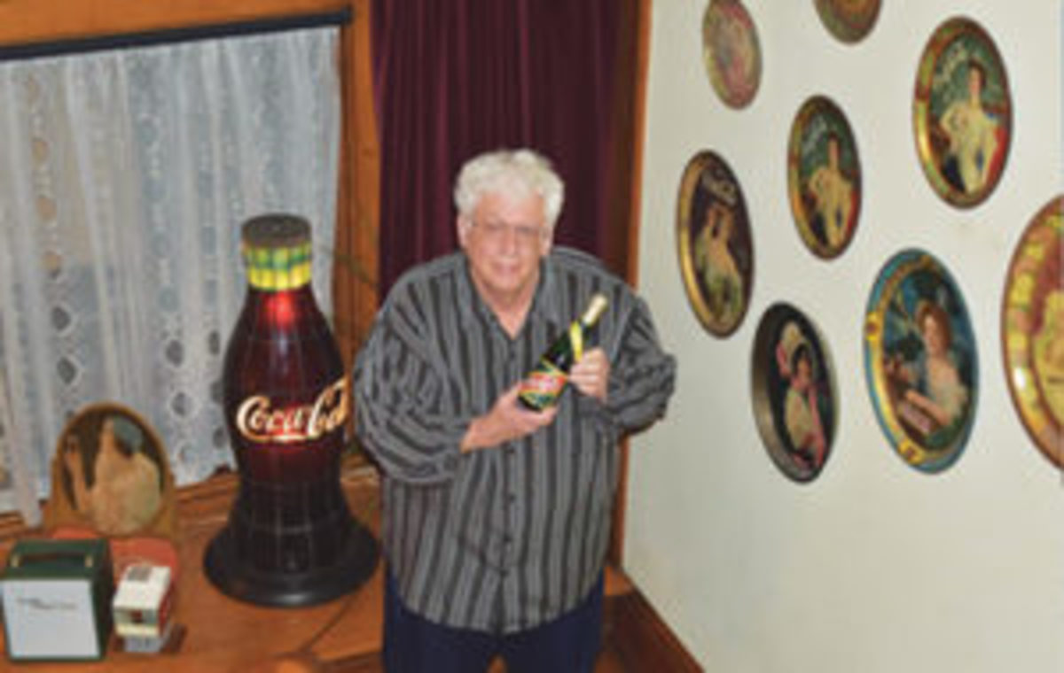 "Bill Bateman, member of the Coca-Cola Collectors Club International, who helped secure permission to use ""Coca-Cola"" in the club's name, shows off part of his collection. Courtesy of Bill Bateman"