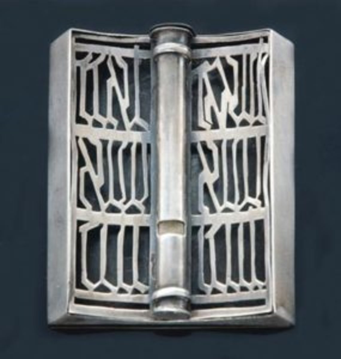 "Israeli sterling silver mezuzah, circa 1950, 2.55"" long, realized $345 including buyer's premium. Courtesy Tiroche Auction House, www.tiroche.co.il"
