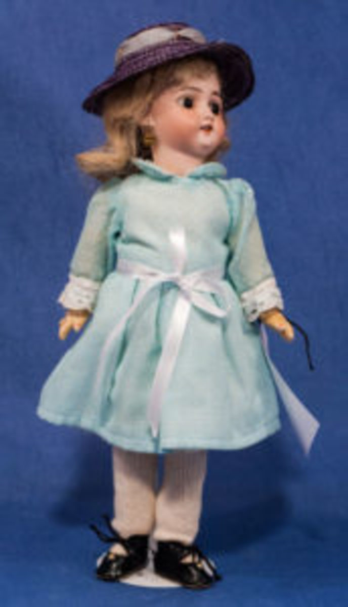 A 14 inch Simon & Halbig German Bisque Doll with artist made clothing and a ball jointed body.