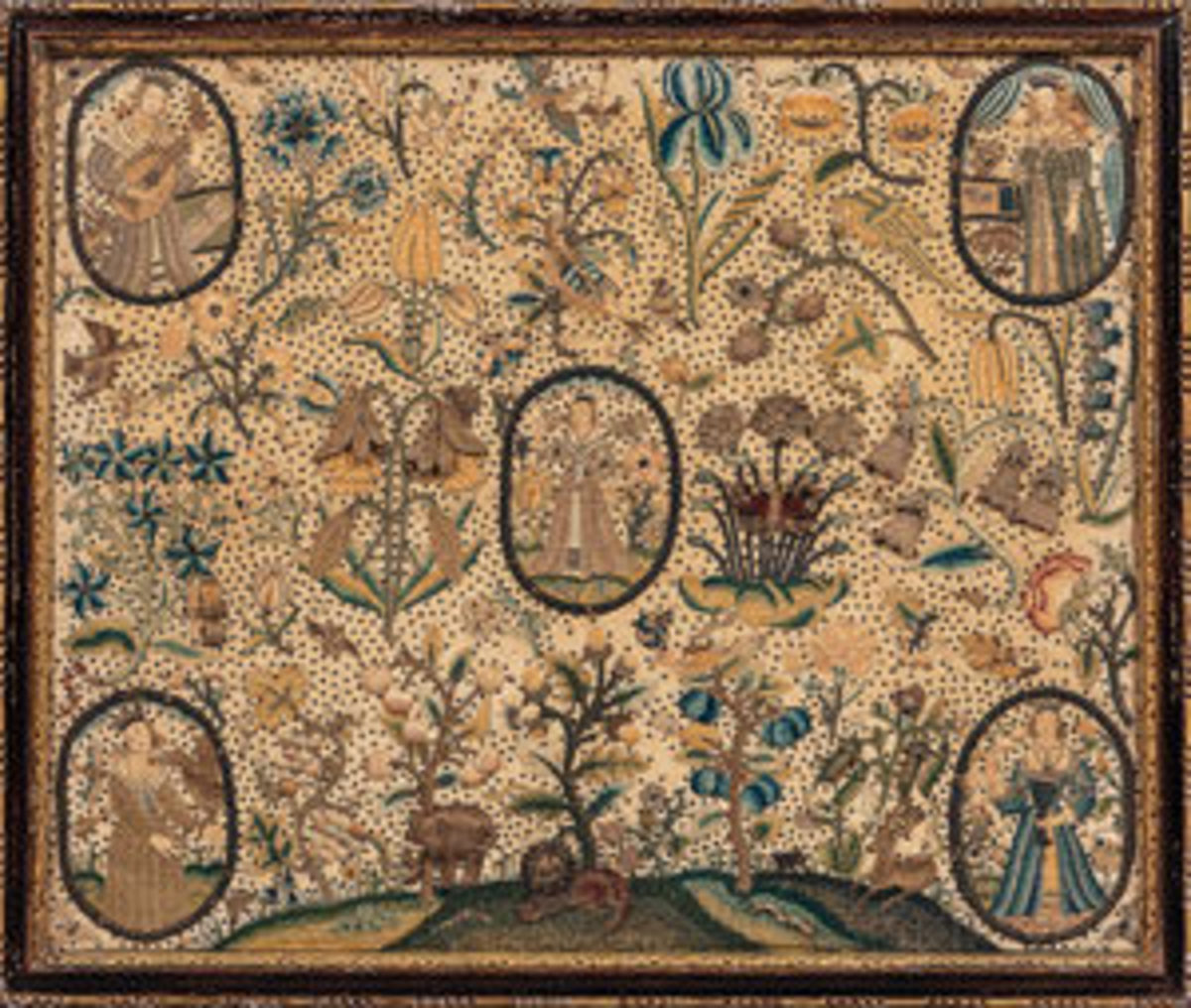 """The Five Senses"" stumpwork picture, England, 17th century, stitched in silk and metallic threads on a silk background depicting the five senses in oval vignettes against a background of flowers, fruit trees, birds, and animals, framed, 23-1/2"" h, 28"" w, sold at Skinner for $17,220 - thousands more than its estimate of $2,000-$4,000. Image courtesy of Skinner Auctioneers and Appraisers"