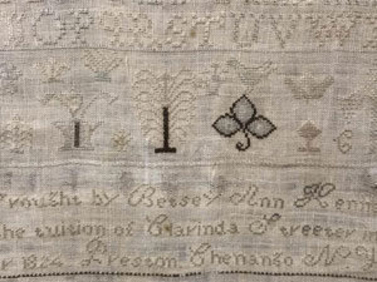 "This linen and silk sampler signed and dated, ""This Wrought by Betsey Ann Kenney, under the tuition of Clarinda Streeter in the year 1824. Preston, Chenango, N. York,"" features the alphabet embroidered in various sizes, along with floral motifs and inscription. It measures approx 18"" h x 13"" w and sold for $325; estimate was $100-$300. Image courtesy of The Benefit Shop"
