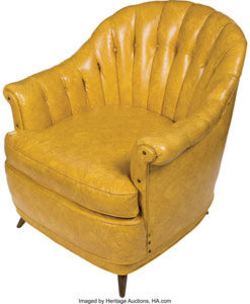 "Elvis Presley's ""King"" chair, a 1960s period-piece yellow leather chair, once resided in Graceland. It was part of a set that Elvis kept in his rec-room, where he was unofficially crowned the ""King of Rock 'n' Roll"" by a founder of one of his first fan clubs, Joyce Gentry. Along with the chair are two photographs of Elvis on that day, with the chair in the background in the photo at bottom left, and Joyce ""crowning"" Elvis as he sits on a matching yellow leather ottoman in the photo at bottom right. The chair, approx. 34"" x 33"" x 32"", sold at auction for $3,250. Images courtesy of Heritage Auctions"