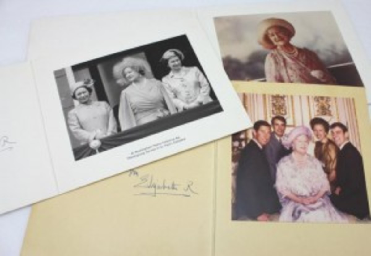 A collection of nine Christmas cards from Queen Elizabeth, circa 1980s, each signed in ink by the Queen, may command between $800 and $1,200.