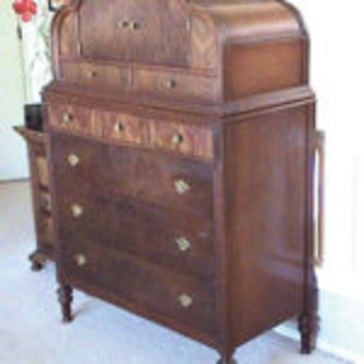 A final step in the evolution of the chiffonier was the chifforette with the placement of the doors on top of a chest that opened to reveal sliding trays similar to those of a linen press.